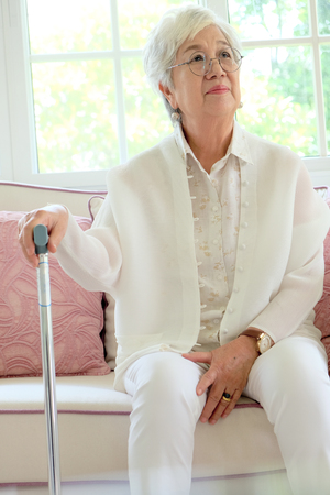 cane sofa: senior woman portrait Stock Photo