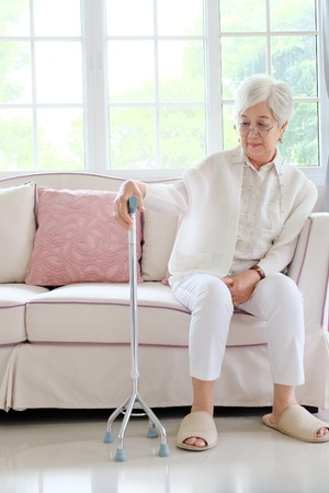 only adult: Retired woman with her walking stick Stock Photo