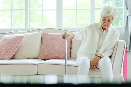 Retired woman with her walking stick Stock Photo