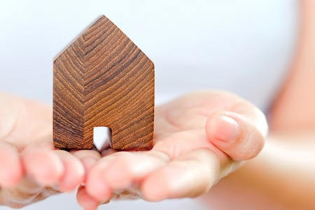 home loan: hand holding icon house, concept image of make your house