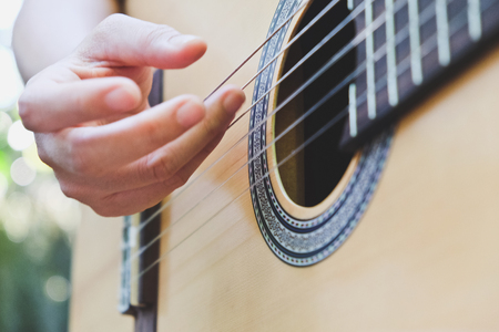 adult entertainment: playing acoustic guitar