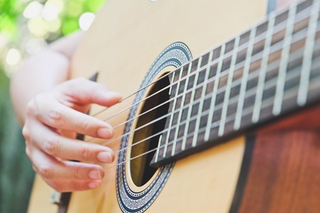 playing acoustic guitar background