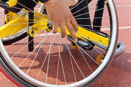 competitive sport: Detail image of wheelchair race on track,wheelchair race