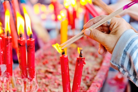 People light the candle at chinese temple Stock Photo
