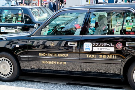 TOKYO, JAPAN - APRIL5, 2017 :Taxi cars on the street near the ueno station in Tokyo on APRIL5, 2017 in Tokyo, Several taxi cabs are waiting in line along the sidewalk. Editorial