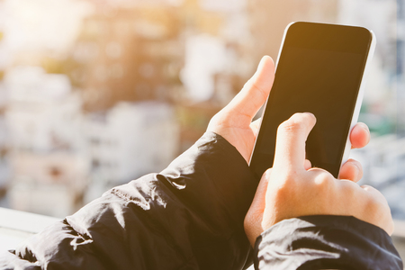 Mobile devices,Close up image of using mobile smart phone Stock Photo