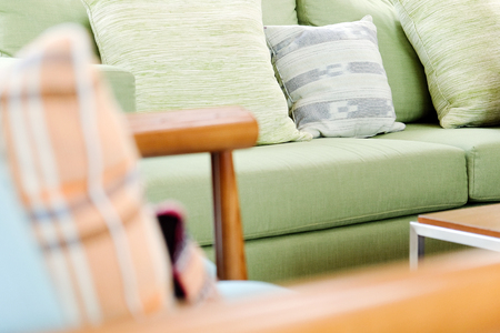 green couch: Detail of modern living room,Cushion on sofa