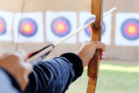 Archer holds his bow aiming at a target Banco de Imagens