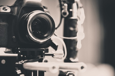 Detail of Video camera , film crew production, behind the scenes background Stock Photo