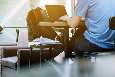 Asian man using laptop in cafe Stock Photo