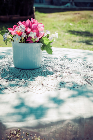 flowers bouquet on wooden garden table