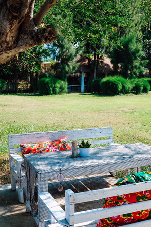Image of Empty table in the houses garden. Stock Photo