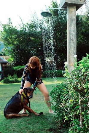 Asian woman washing her pet dog Stock Photo