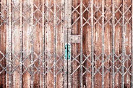Old vintage style zinc sliding door Stock Photo
