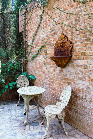 Old vintage furniture in garden Stock Photo