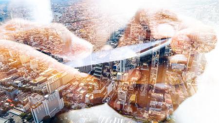 Double exposure of cityscape and smart phone 版權商用圖片