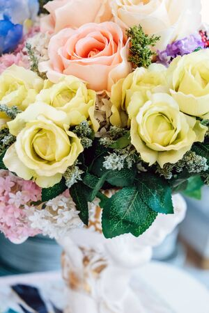 Floral background. artificial flowers in a colorful