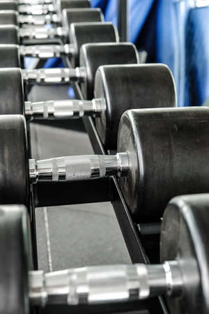 Close up image of Fitness equipment dumbbells weight,Gym background Stock Photo