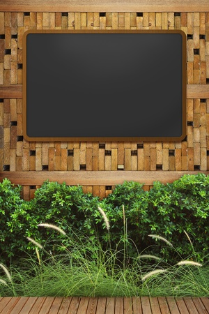 empty blackboard with wooden frame on wood wall photo
