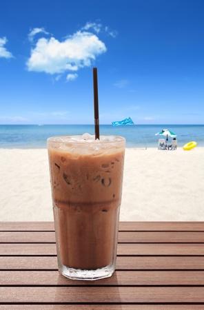 ice cream glass: ice coffee on the beach Stock Photo