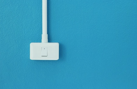 switches: Light switches on the blue wall
