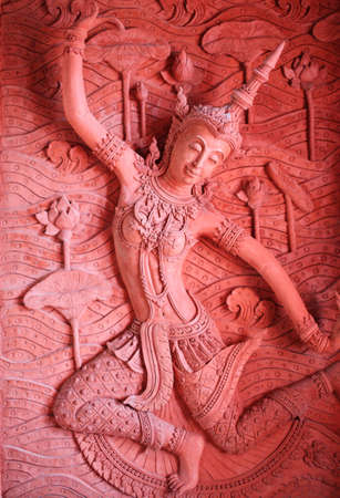 angel red stucco art on the wall photo