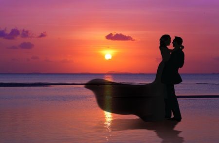 Married Couple on sunset beach Stock Photo