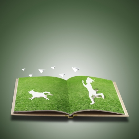 Paper cut of children play on grass book  photo