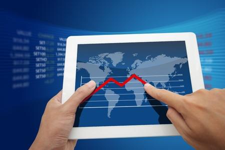 Hand holding a world  graph  photo