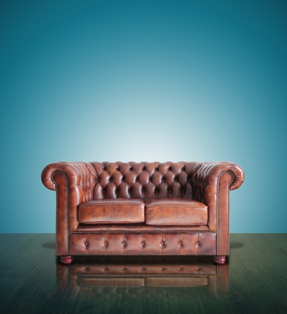 Classic Brown leather sofa and old blue background  photo