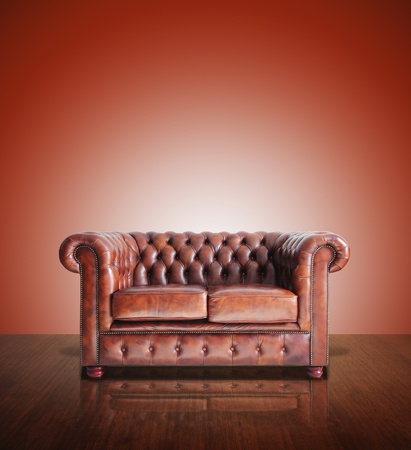 Classic Brown leather sofa and old red wood background   photo