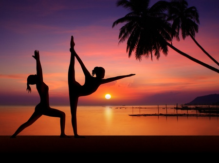 Silhouette of Yoga woman in sunset photo