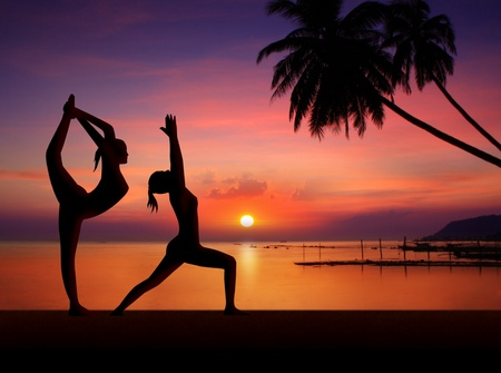 girls doing yoga in sunset photo