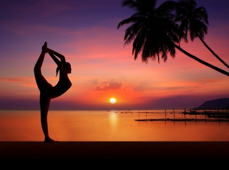 standing water: Yoga girl on sunset Stock Photo