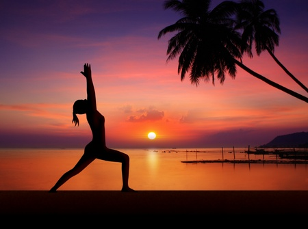 Yoga girl in sunset Silhouette photo