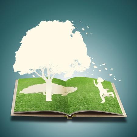 paper cut: Paper cut of children play on grass book