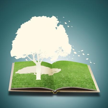 paper cut: Papier gesneden van de boom op gras boek