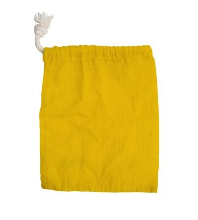 yellow fabric bag on white isolated background   photo