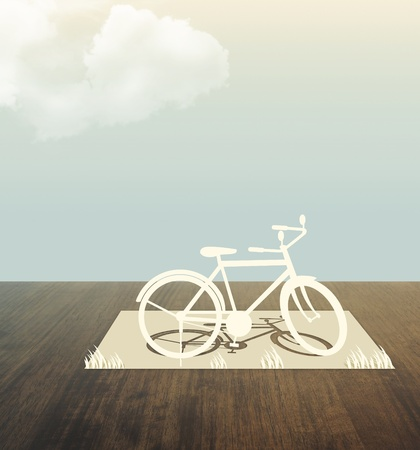bicycle Paper cut on wood table photo
