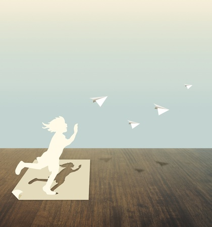 paper cut: Paper Cut van kind op houten tafel
