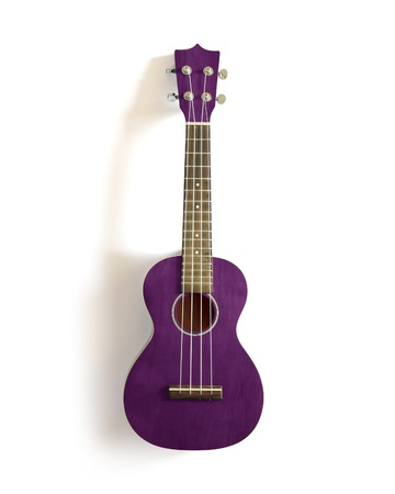 acoustic ukulele: violet old ukulele on white isolated  Stock Photo