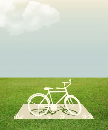 Paper cut of bicycle on green grass dream concept style photo