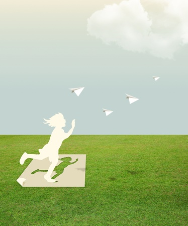 Paper cut of child on green grass dream concept