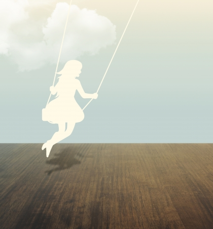 swinging: silhouette of girl on swing under sky paper cut style Stock Photo