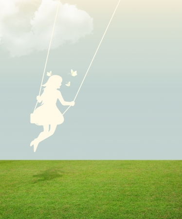 silhouette of girl on swing under sky with butterfly paper cut style photo
