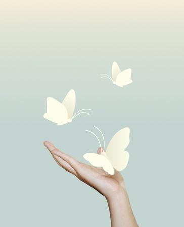 paper cut: vlinder papier bij de hand papier gesneden stijl Stockfoto