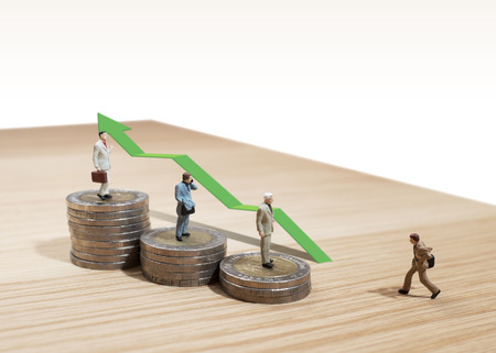 mobile advertising: business man miniature concept move to success business finance and marketing Stock Photo