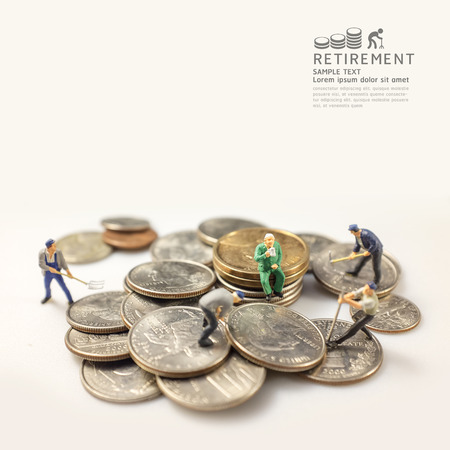 invest: businessman miniature figure after retirement concept warm tone and focus on old man.