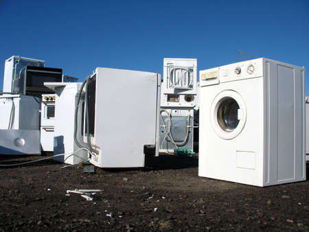 White goods in a dump with no visual brand names. Foto de archivo