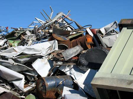 Metal scrap with no visual brand names on a dump Foto de archivo
